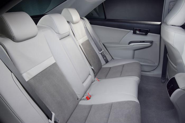 2012_Toyota_Camry_Hybrid_BackSeat_700x467